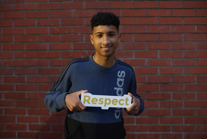 Young man with 'Respect' sign