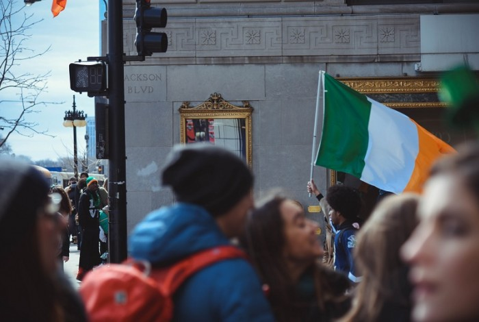 People on Dame Street protesting for equality with an Irish flag